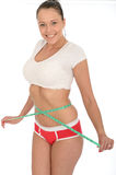 Healthy Happy Pleased Young Woman Checking Her Weight Loss With a Tape Measure Royalty Free Stock Images