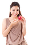 Healthy, happy, smiling woman with red apple Royalty Free Stock Images