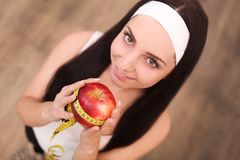 Healthy happy woman with apple and tape measure for diet and weight loss concept.  Stock Photo