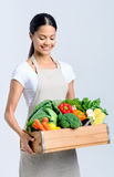Healthy happy woman with crate of vegetables Stock Image
