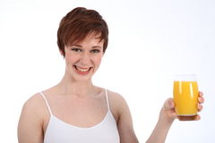 Healthy happy woman holding glass of orange juice Royalty Free Stock Photography