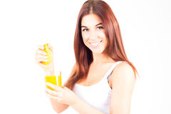 Free Healthy Happy Woman Squeezes Juice From Orange And Looking At Camera. Healthy And Right Food. Stock Images - 69955264