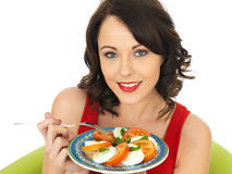 Healthy Happy Young Woman Eating a Mozzarella Cheese and Tomato Salad Stock Photography