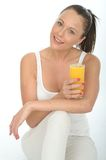 Healthy Happy Young Woman Holding a Glass Of Fresh Orange Juice Stock Photos