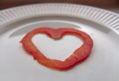 Healthy heart. Red pepper heart on a plate, symbolizing love, love of food, healthy eating etc Royalty Free Stock Photos