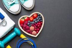Healthy heart  diet and sport gym equipment concept on blackboard. Background Royalty Free Stock Image