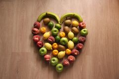 Free Healthy Heart Fruits With Apples, Lemons, Apricots And Peaches Stock Photos - 153418623