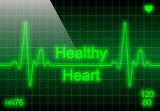 Healthy heart on green heart rate monitor Royalty Free Stock Photo
