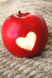 Healthy Heart Red Apple. Healthy red apple with a heart carved into it stock images