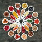 Healthy Heart Superfood. With fresh fruit, vegetables, fish, nuts and medicinal herbs. High in antioxidants, vitamins, minerals and omega 2 fatty acids. Top royalty free stock photo