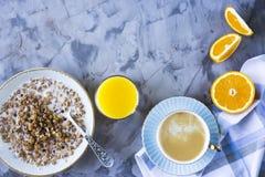 Healthy hearty breakfast - copy space. A healthy hearty breakfast - muesli, coffee, orange and juice. Copyspace Royalty Free Stock Images