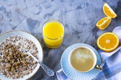 Healthy hearty breakfast - copy space. A healthy hearty breakfast - muesli, coffee, orange and juice. Copyspace Stock Images