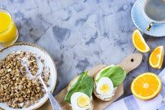 Healthy hearty breakfast - copy space. Healthy hearty breakfast - muesli, sandwich with egg, coffee, orange and juice. Copyspace Royalty Free Stock Photo