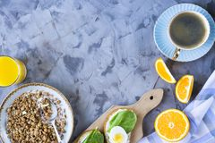 Healthy hearty breakfast - copy space. Healthy hearty breakfast - muesli, sandwich with egg, coffee, orange and juice. Copyspace Stock Image