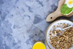 Healthy hearty breakfast - copy space. Healthy hearty breakfast - muesli, sandwich with egg, coffee, orange and juice. Copyspace Stock Images