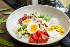 Healthy Hearty Cobb Salad with Chicken Bacon Tomato Onions and Eggs. American food. Close up, home made stock images