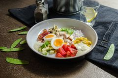 Healthy Hearty Cobb Salad with Chicken, Bacon, Tomato, Onions, Eggs, green beans. American food. Close up, home made. Cuisine stock images