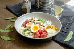 Healthy Hearty Cobb Salad with Chicken, Bacon, Tomato, Onions, Eggs, green beans. American food. Close up, home made. Cuisine royalty free stock photos