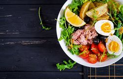 Healthy hearty salad of tuna, green beans, tomatoes, eggs, potatoes, black olives stock photography