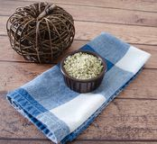 Healthy Hemp Hearts. In a brown bowl on napkin.  Wicker pumpkin decoration and napkin.  Close up and copy space Royalty Free Stock Photos