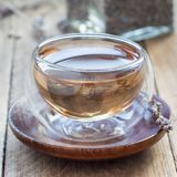 Healthy herbal lavender tea in oriental glass cup, square format. Healthy herbal lavender tea in oriental glass cup, square royalty free stock images