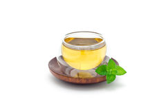 Healthy herbal mint tea in oriental glass cup isolated on white, horizontal Stock Photography