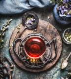 Healthy herbal tea concept , cup of tea with fresh herbs and flowers on rustic vintage background Royalty Free Stock Images
