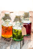 Healthy herbs in bottles as natural medicine Royalty Free Stock Image