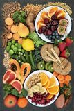 Healthy High Fiber Dietary Food Selection. Healthy high fibre dietary food concept including fruit, vegetables, legumes, nuts, whole wheat pasta and whole grain royalty free stock photos