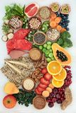 Healthy High Fibre Diet Food. Healthy high fibre dietary food concept with fruit, vegetables, nuts, seeds, cereals, whole grain seeded crackers, whole wheat stock photo