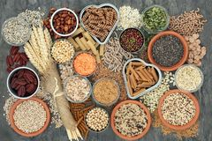 Healthy High Fibre Food. Healthy high fibre dietary food concept with whole wheat pasta, legumes, nuts, seeds, cereals, grains and wheat sheaths. High in omega 3 stock photo