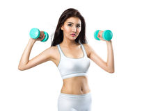 Healthy hispanic young asian woman with dumbbells working out Royalty Free Stock Images