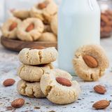 Healthy homemade almond cookies without butter and flour, served with a milk, square format Stock Photos