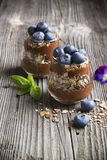 Healthy homemade breakfast. Chocolate banana smoothie with crunchy granola and fresh berries blueberry royalty free stock photo