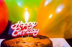 Healthy homemade cake with balloons and candle Royalty Free Stock Images