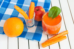 Healthy homemade carrot juice in glass and fresh Stock Images