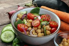 Healthy homemade chickpea and veggies salad, diet, vegetarian, v Stock Photo