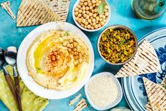 Healthy Homemade Creamy Hummus with Olive Oil and Pita . stock photo