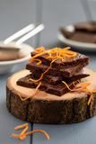Healthy homemade dark chocolate bars with orange rind on wood slabs. Vertical stock images
