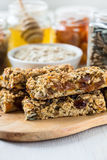 Healthy homemade granola bars and   ingredients  on  background Royalty Free Stock Image