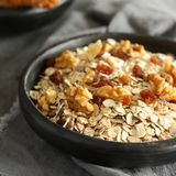 Healthy homemade granola on gray background Royalty Free Stock Photos
