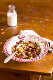Healthy homemade granola or muesli with oats, dried pears, raisin, almonds, hazelnuts and honey in a plate with a spoon and napkin Royalty Free Stock Photography