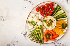 Healthy homemade hummus with assorted fresh vegetables. Concept of healthy, vegetarian, diet food Royalty Free Stock Photography