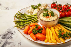Healthy homemade hummus with assorted fresh vegetables. Concept of healthy, vegetarian, diet food Stock Photos