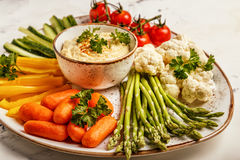 Healthy homemade hummus with assorted fresh vegetables. Concept of healthy, vegetarian, diet food Royalty Free Stock Photo