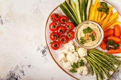 Healthy homemade hummus with assorted fresh vegetables. Concept of healthy, vegetarian, diet food Stock Photography
