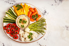 Healthy homemade hummus with assorted fresh vegetables. Concept of healthy, vegetarian, diet food Royalty Free Stock Photos