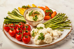 Healthy homemade hummus with assorted fresh vegetables. Concept of healthy, vegetarian, diet food Stock Image