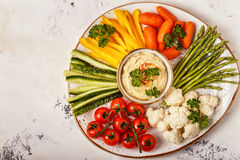 Healthy homemade hummus with assorted fresh vegetables. Concept of healthy, vegetarian, diet food Royalty Free Stock Images