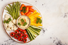 Healthy homemade hummus with assorted fresh vegetables. Concept of healthy, vegetarian, diet food Stock Photo